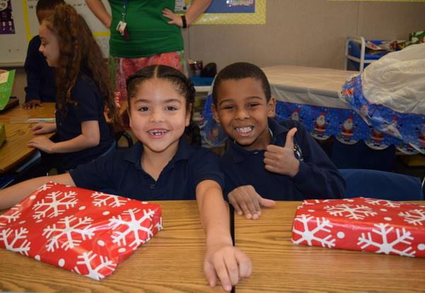 Santa Claus Hand-Delivers Gifts to Students at Annual Santa Brigade