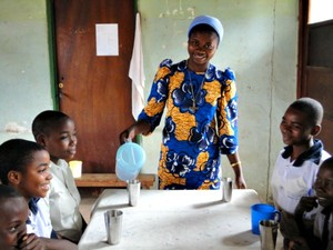 Teacher is providing clean water to students