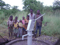 Photo shows The Sisters install bore holes and hand pumps