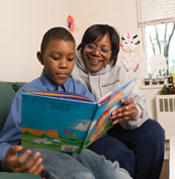 a lady teaching a boy to read