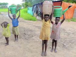 Girls carrying water picture