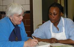Sister Judy works with Sharon, a successful graduate of Power Inspires Progress.
