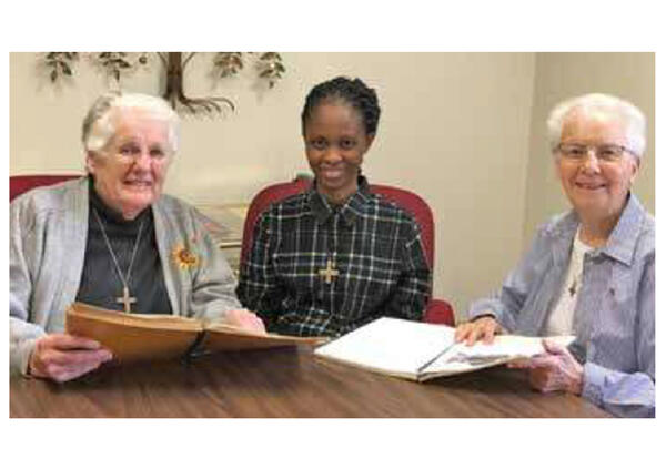 Sister Lois Ann Meyer (left) and Mary Ellen Carinato (right) shared their Montessori Matters educational materials with Sister Jacinta prior to her return to Nigeria.