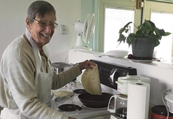 Sister Nancy Wellmeier heats tortillas for the burrito assembly line.
