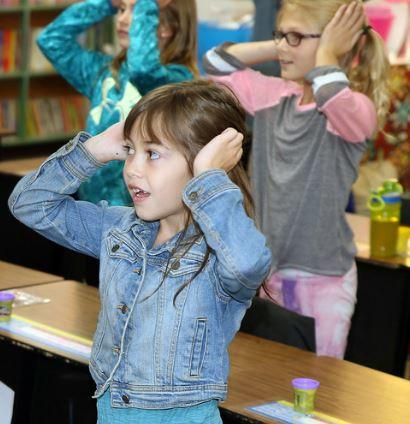 girl participating in classroom activity