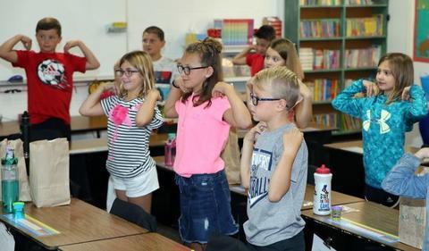 children participating in classroom activity