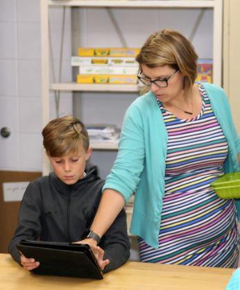 teacher and boy on ipad