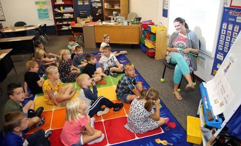 student listening to classroom teacher teach