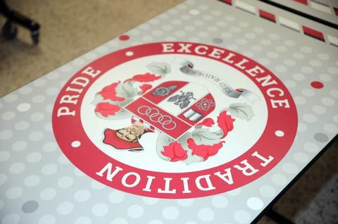 picture of lunchroom table with Pulaski motto