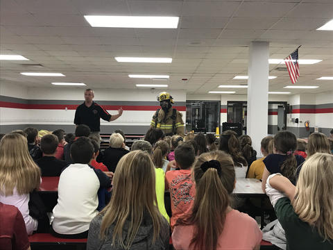 firefighters presenting to students
