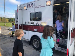 children checking out the inside of a rescue vehicle