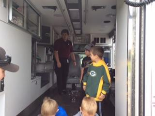 children checking out rescue vehicle