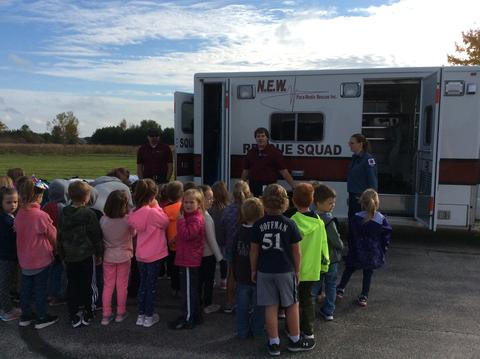 children outside learning about the rescue squad