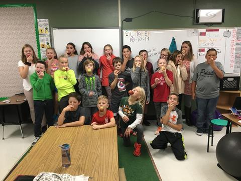 teacher & kids eating apples
