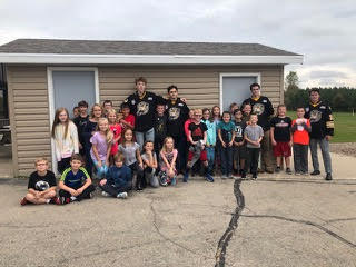 children and Green Bay Gambler players outside