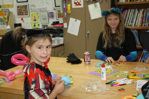 girls doing crafts