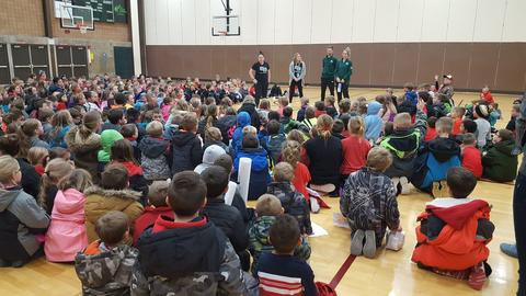 UWGB players speaking to students