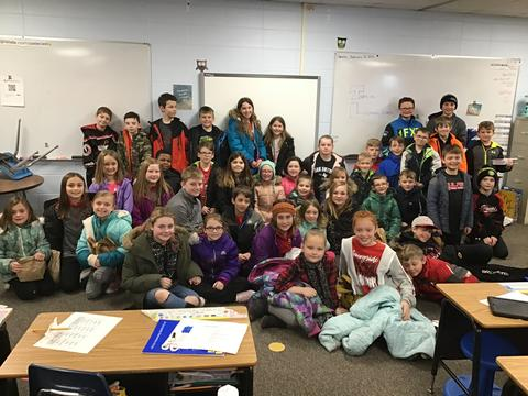 students in classroom ready to leave for field trip