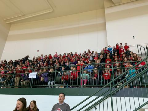 students and staff at basketball game