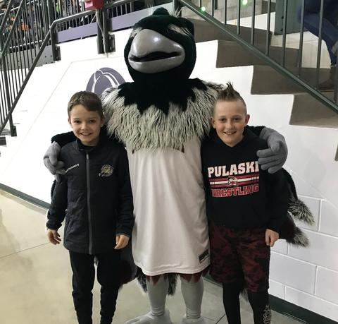 UWGB mascot with a couple students