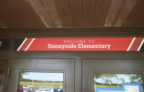 """door with sign above that says """"welcome to Sunnyside"""""""
