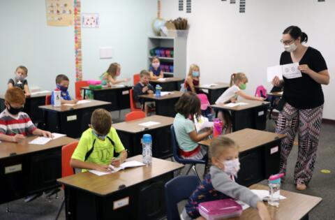 teacher in classroom teaching her students