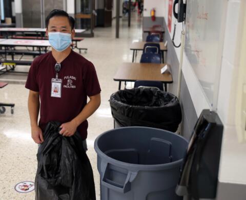 custodian changing the garbage bags