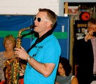Principal playing the saxophone