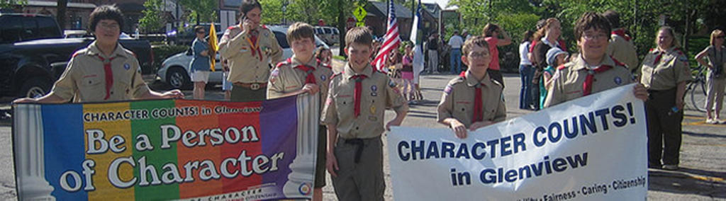 Character Counts banner held by Boy Scouts