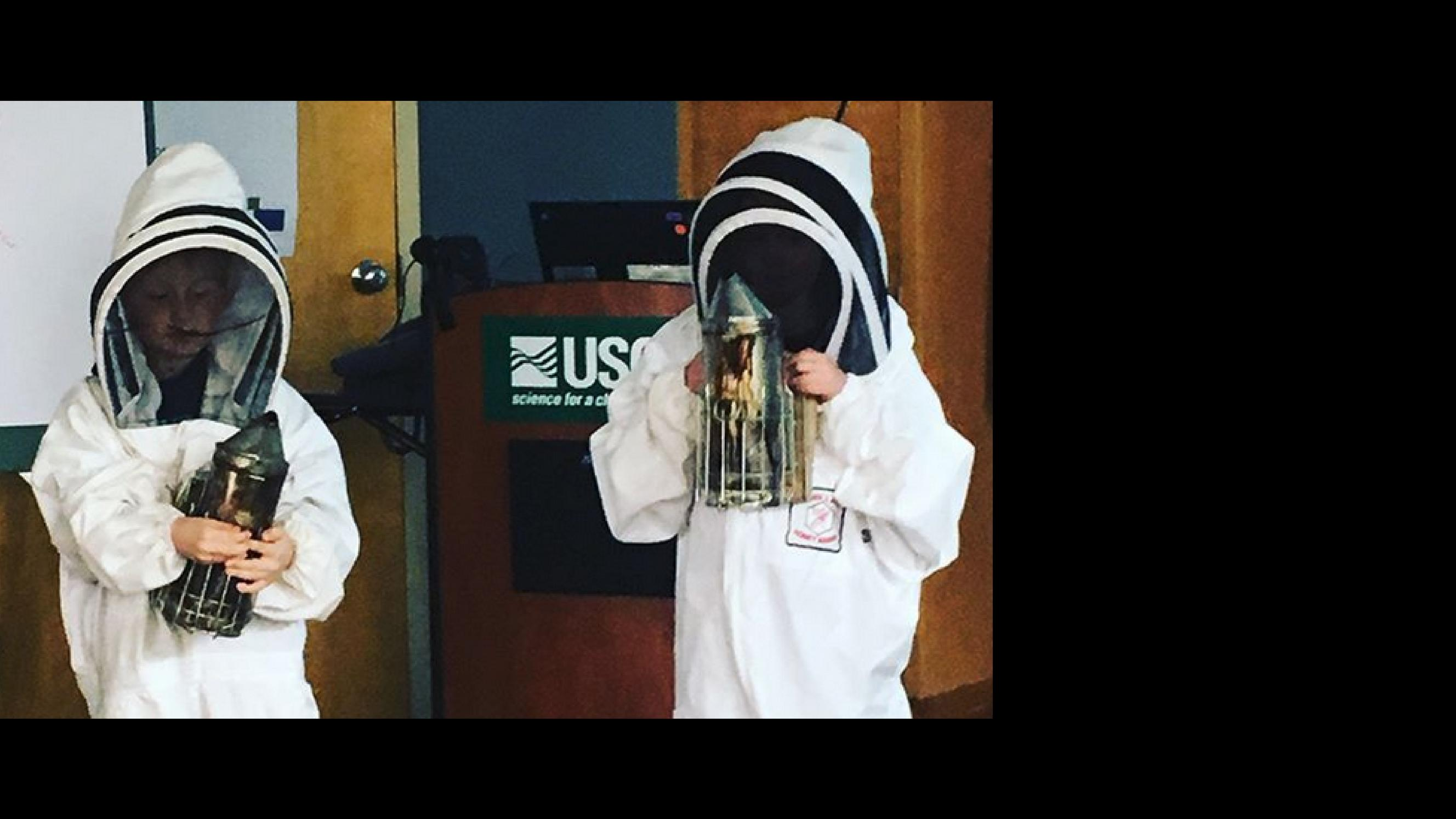 Two Gussner 1st Grade Students Demonstrating Bee Keeping at Northern Plains  Research Center