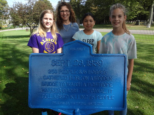 Students paint NYS marker with Clarendon Historian