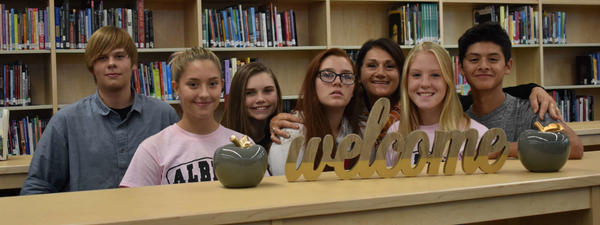 Della Morales, Library Media Specialist, poses with students in the newly renovated library.
