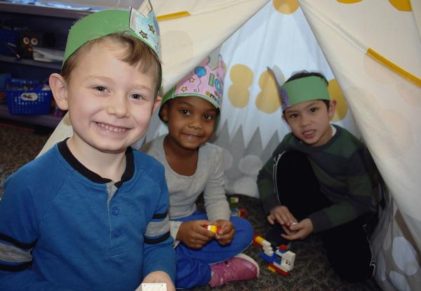 Students play games in a teepee.