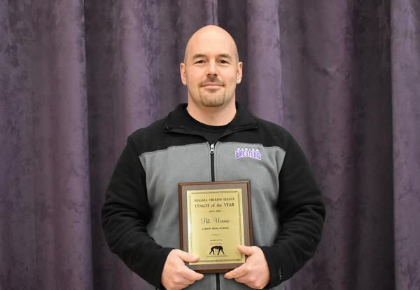 Head Coach Pat Uveino with his award.