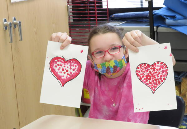 Students working on creating valentines for veterans.