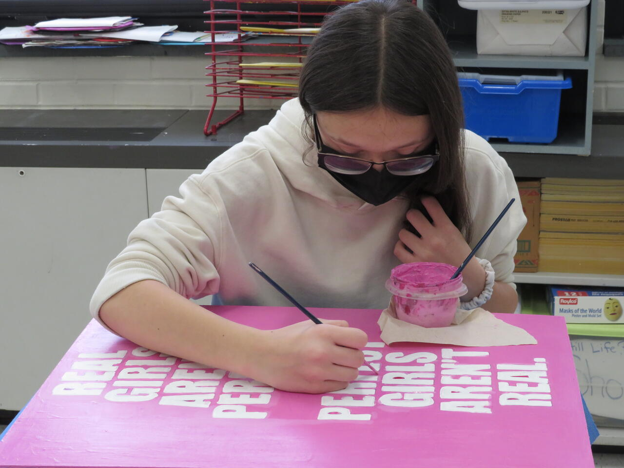 Leaving a Legacy: Eighth-graders design, paint mural for bathrooms