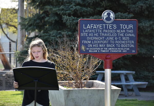 Kaitlin Bennett giving the history of Marquis de Lafayette during the ceremony.