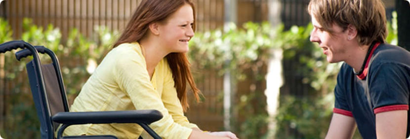 Student on a wheelchair enjoying a conversation with fellow student