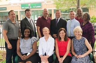 Board members, administrators, teachers, and staff