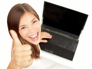 Girl with computer giving thumbs up