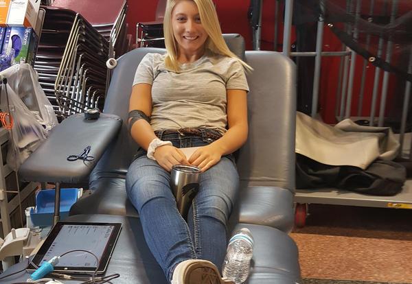 girl donates blood