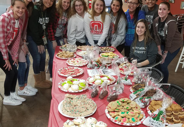 students with cookies for sale