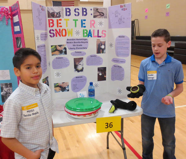 2 boys with snowball maker invention