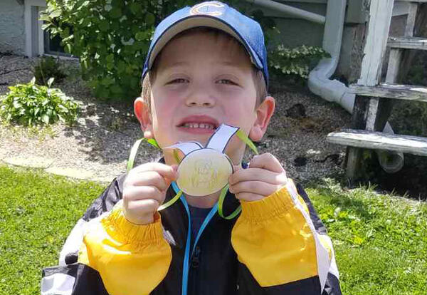 boy with paper medal