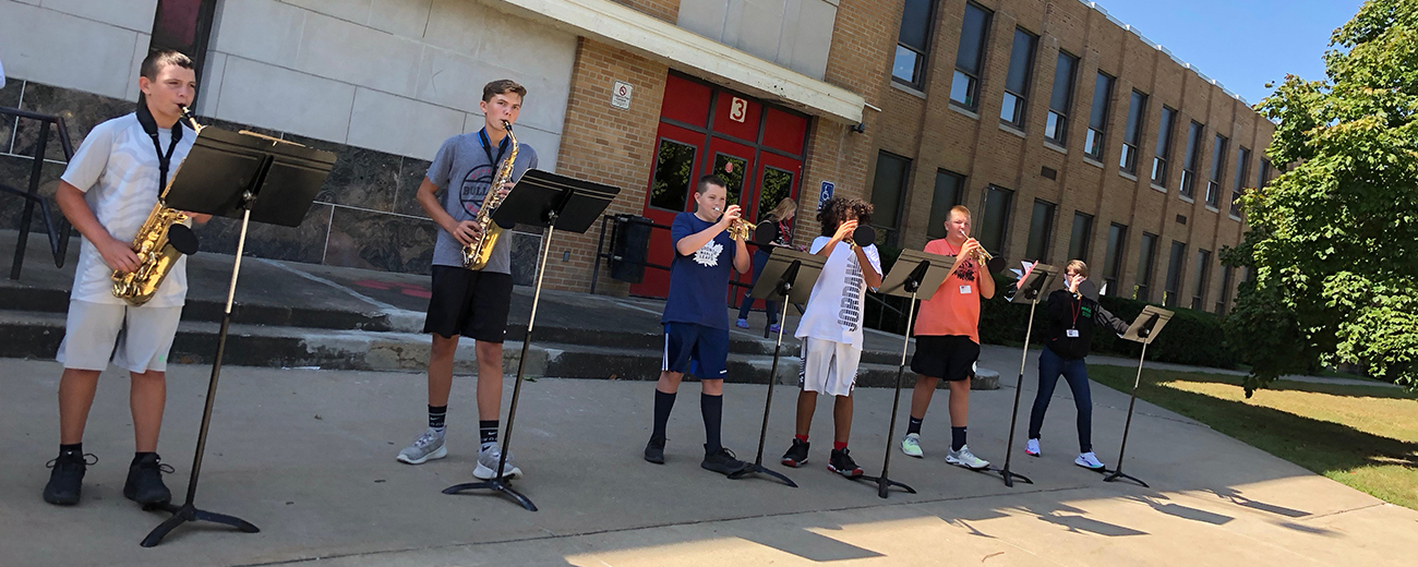 evans band members play outdoors