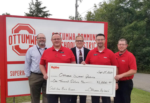 Representatives from Ottumwa Hy-Vee stores with Superintendent Mike McGrory and Principal Jay Green.